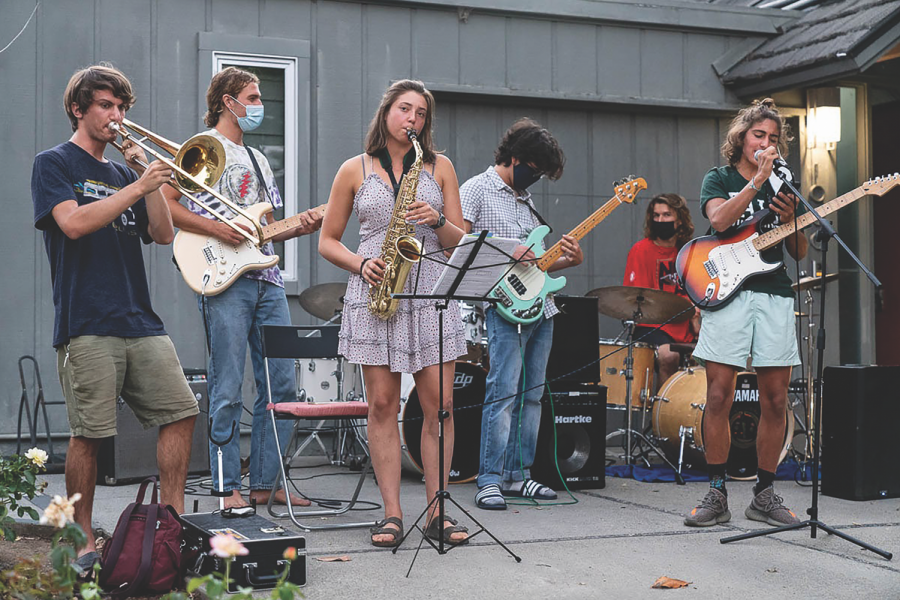 GoodFastCheap gathers for the first time in a while to play for neighbors. Photo by Rhys Gwyn.