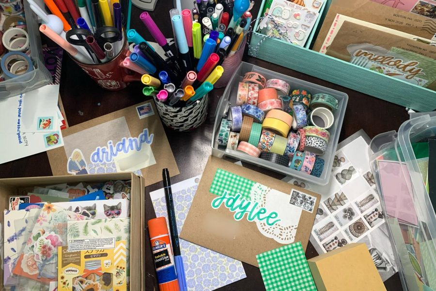 Melody Xu's workspace is covered in pens, tape, stationary and more which she artfully utilizes to create her beautiful letters. (Melody Xu)
