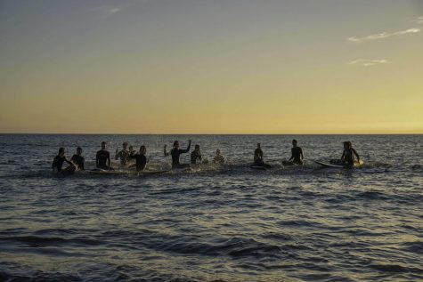 The Surf Club meets up for a sunset session at the Half Moon Bay Jetty. Photo courtesy of Alexa Gwyn.